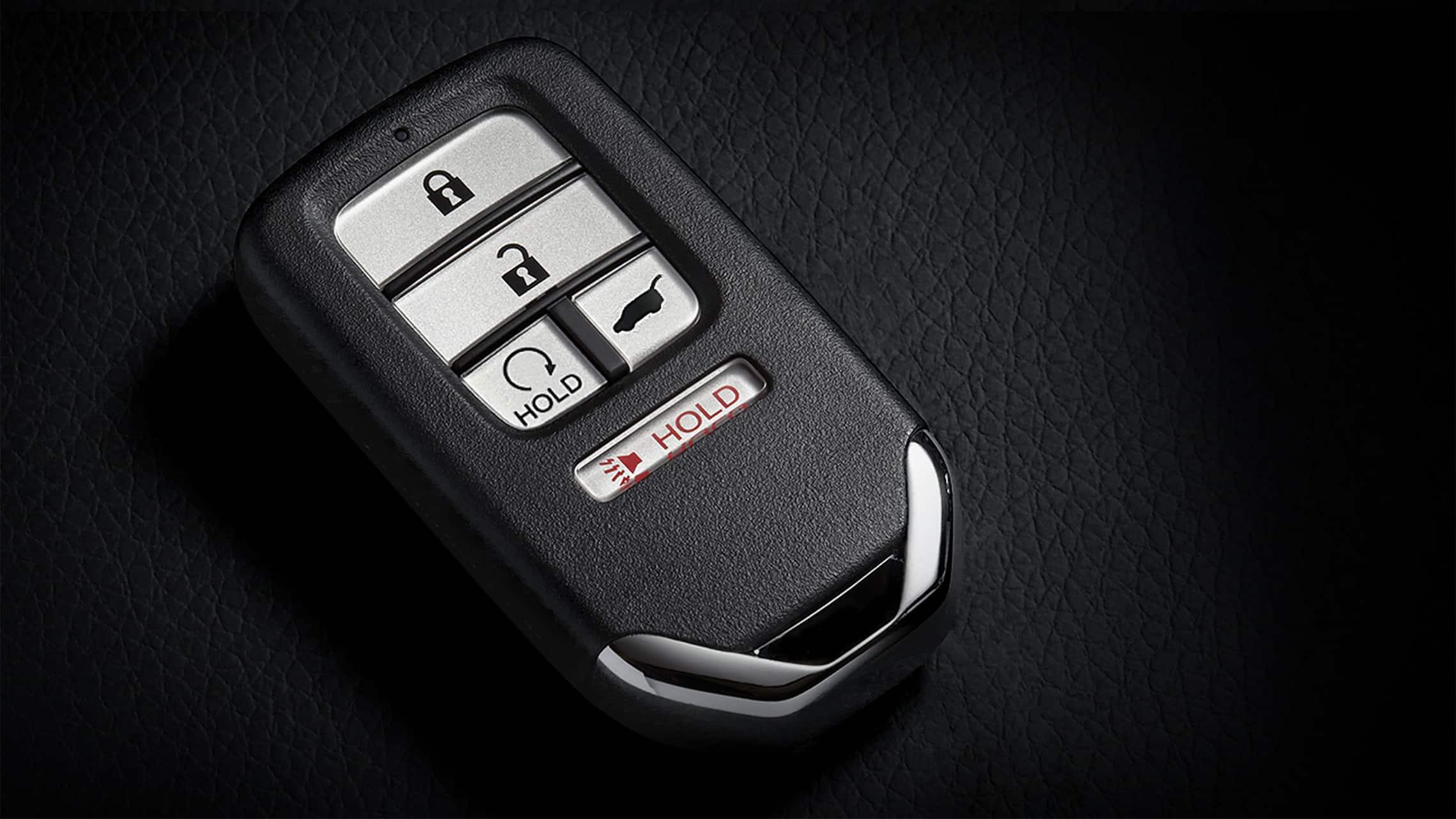 Llavero con detalle del botón de encendido remoto del motor para el Honda Civic Sport Touring Hatchback2021.